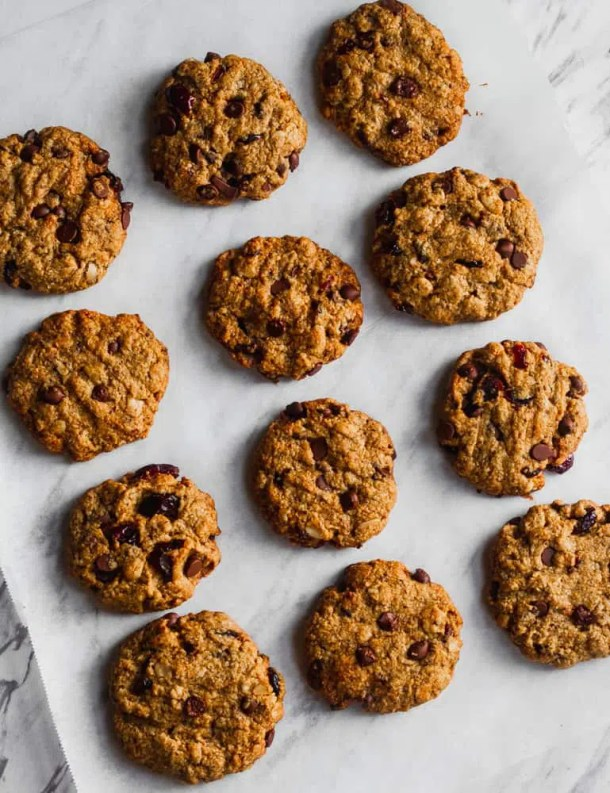 chewy oatmeal cranberry chocolate chip cookies on parchment paper