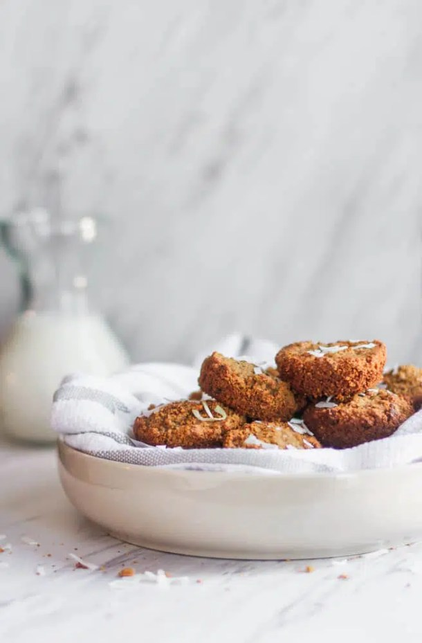 healthy breakfast muffins with coconut flakes in white bowl