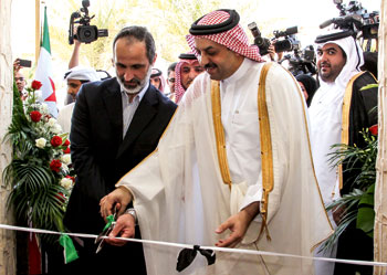 Former Syrian coalition leader Moaz al-Khatib (left) and the Qatari minister for foreign affairs Khalid al-Attiyah opening the Syrian Arab Republic embassy in Qatar, March 2013