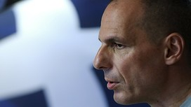 "Greek Finance Minister Yanis Varoufakis arrives to make a statement in Athens, Greece, in this July 5, 2015 file picture. Greek Finance Minister Yanis Varoufakis announced his resignation on July 6, 2015, a day after Greeks delivered a resounding 'No' to the conditions of a rescue package. In a statement, Varoufakis said he had been ""made aware"" that some members of the euro zone considered him unwelcome at meetings of finance ministers, ""an idea the prime minister judged to be potentially helpful to him in reaching an agreement."" REUTERS/Alkis Konstantinidis/Files"