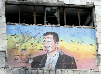 A portrait of Bashar al-Assad in Aleppo after parts of the city were captured by rebels, March 2013