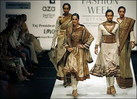 Fashion industry  A story of consumption and waste   Rediff com Business Models present creations by Indian designers Ekta and Ruchira