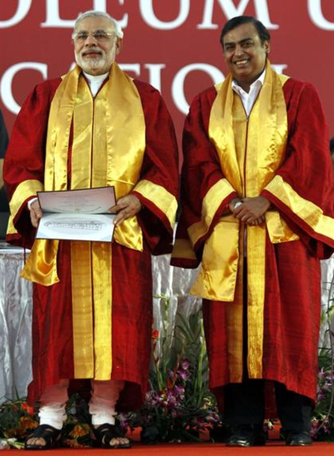 Narendra Modi (L) and Mukesh Ambani, attend a convocation ceremony at Pandit Deendayal Petroleum University in Gujarat.