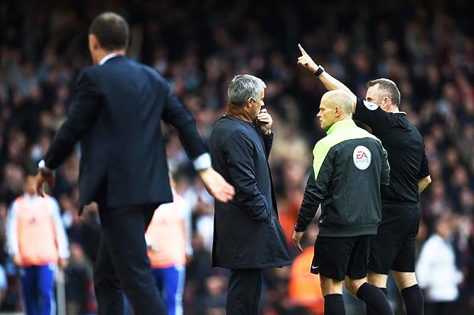 Chelsea manager Jose Mourinho looks on as Referee Jonathan Moss sends him to the stands along with goalkeeping coach Christophe Lollichon and assistant first team coach Silvino Louro