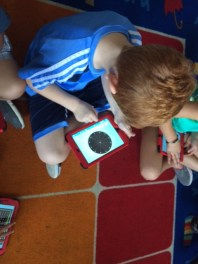 We used an app to make shapes on electronic geoboards.