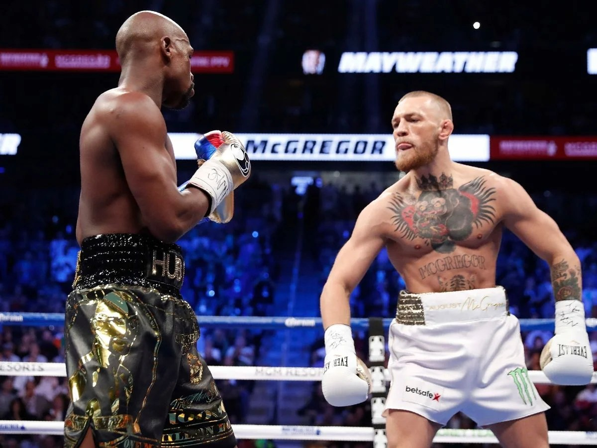 """Photo of """"""""They Offered Me $1.5 Million But I Hung Up On Them""""- Floyd Mayweather's Team Reveals Bizarre Offer By Conor McGregor – EssentiallySports"""