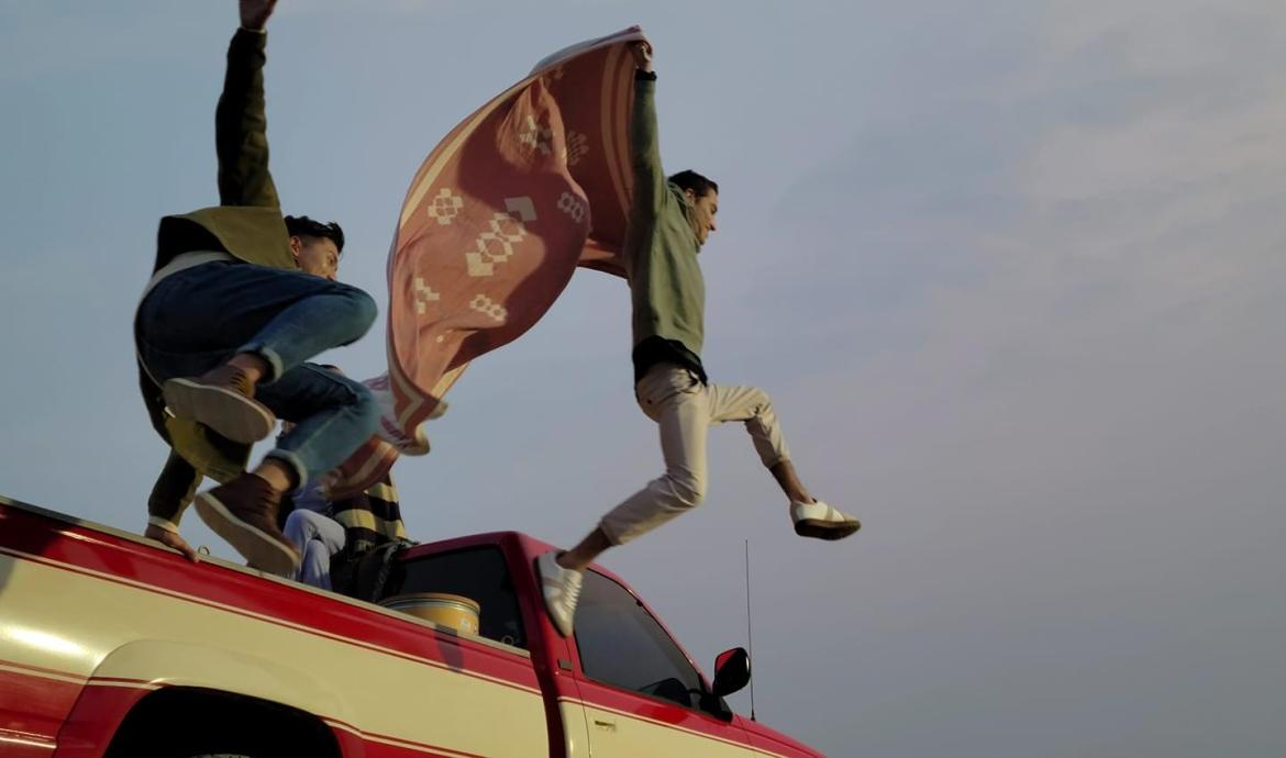 Three friends riding in a pickup truck, with two jumping out of the back. Scene shot with 8K video mode, and one still cut captured with 8K Video Snap.
