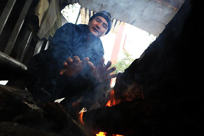 Rét 10 độ C, người Hà Nội trùm chăn, mặc áo mưa ra đường - 5