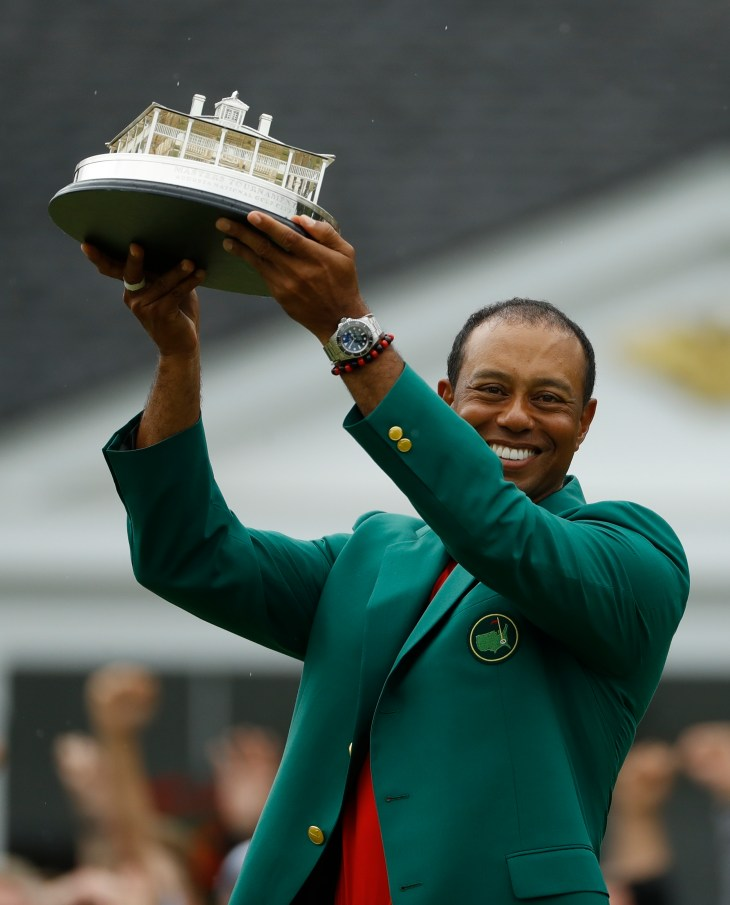Tiger Woods celebrates winning his fifth Masters title