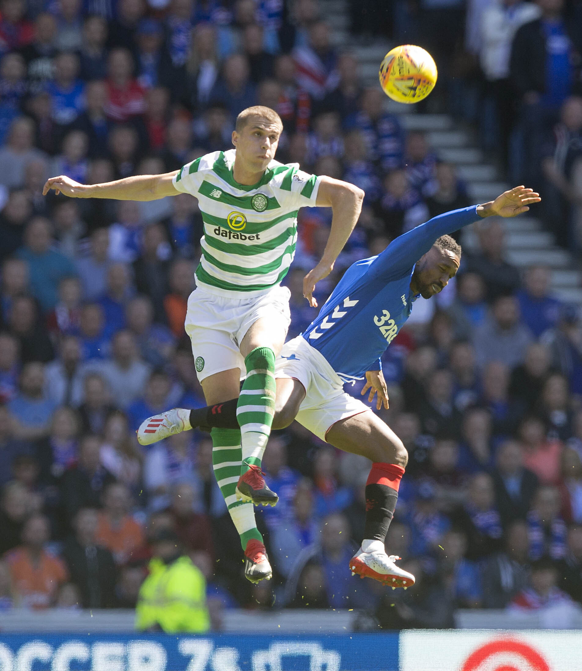 Celtic's Jozo Simunovic (left) has escaped punishment after clashing with Jermain Defoe