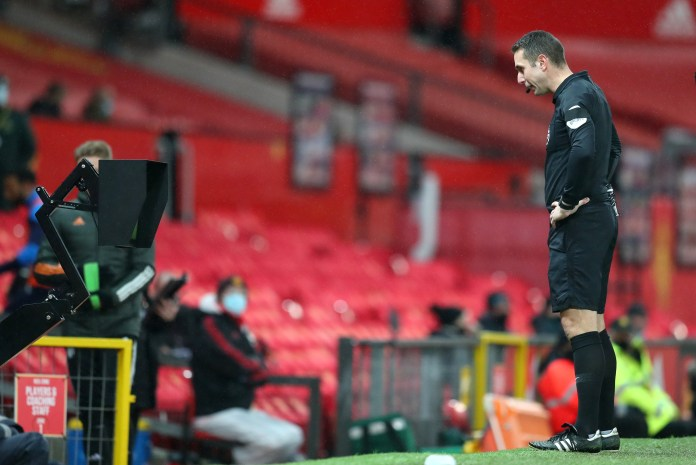 Referee David Coote consults VAR before overturning his decision to award West Bromwich Albion a penalty for a foul on West Brom