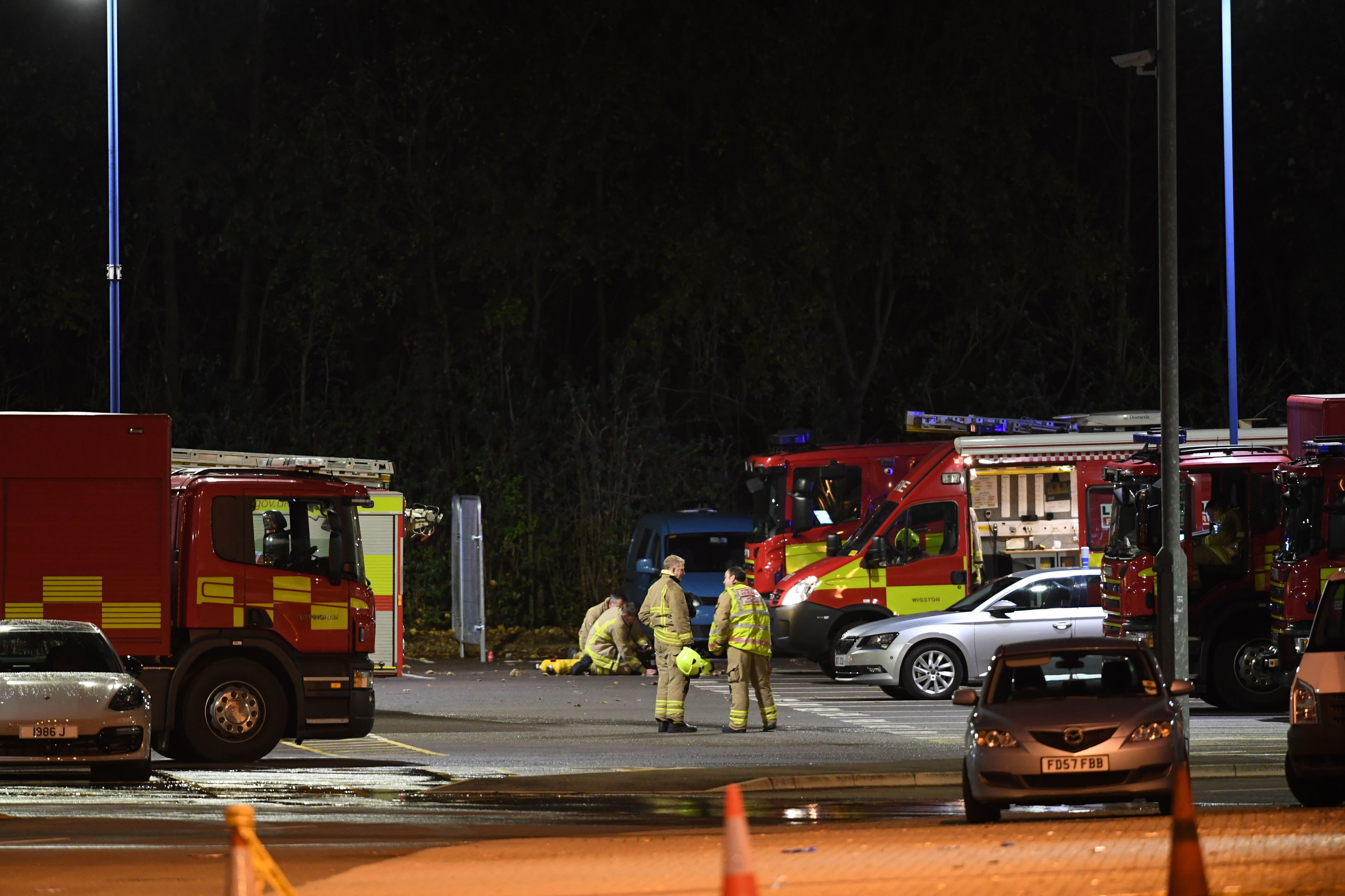 The emergency services outside the King Power Stadium in Leicester after a helicopter belonging to Leicester City Football Club owner Vichai Srivaddhnaprabha crashed in a car park (Joe Giddens/PA)