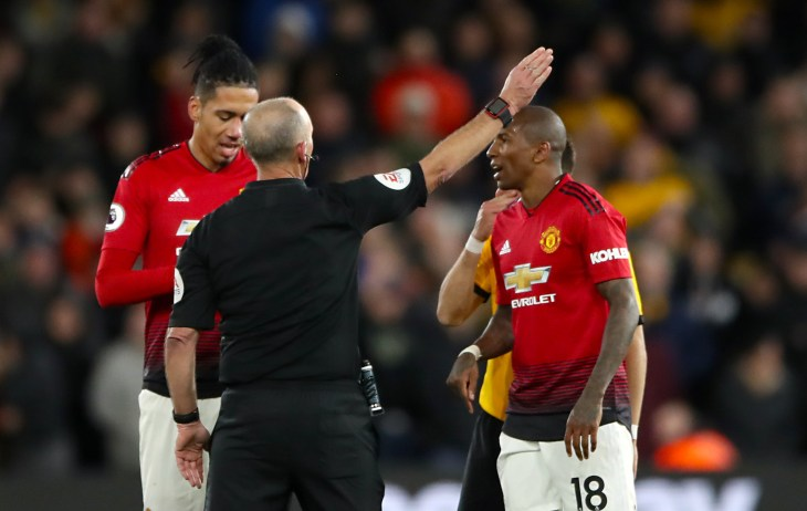 Mike Dean sends off Manchester United's Ashley Young