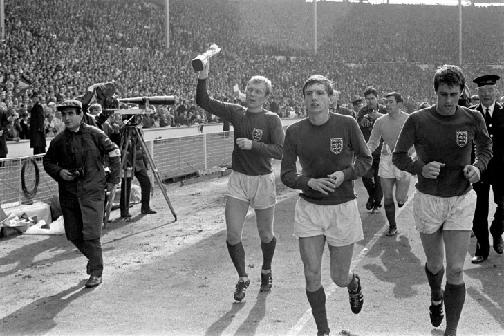 England captain Bobby Moore, left, parades the World Cup around Wembley alongside Martin Peters, second left, Geoff Hurst, right, and Gordon Banks