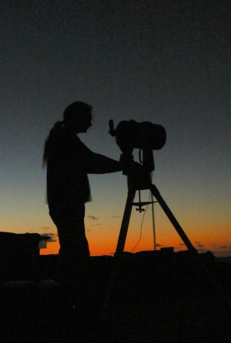 A member of Basingstoke Astronomical Society using a telescope
