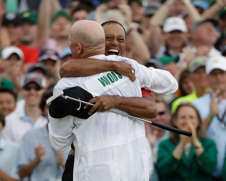 Tiger Woods celebrates with his caddie Joe LaCava