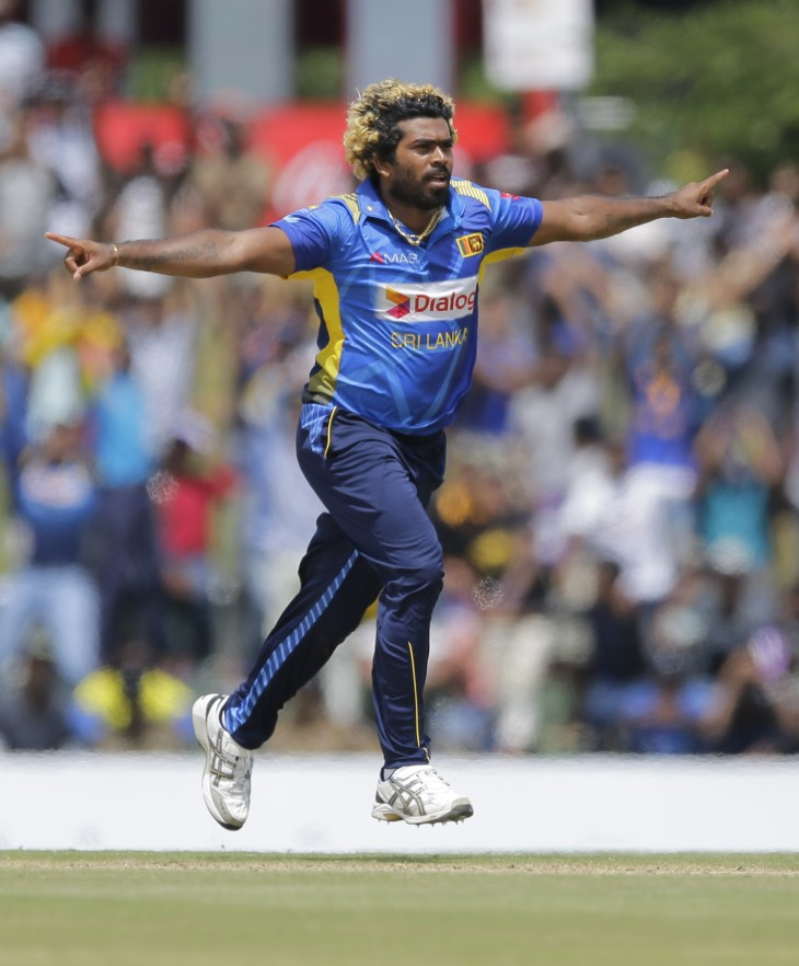 Sri Lanka's Lasith Malinga celebrates the dismissal of England's Liam Dawson