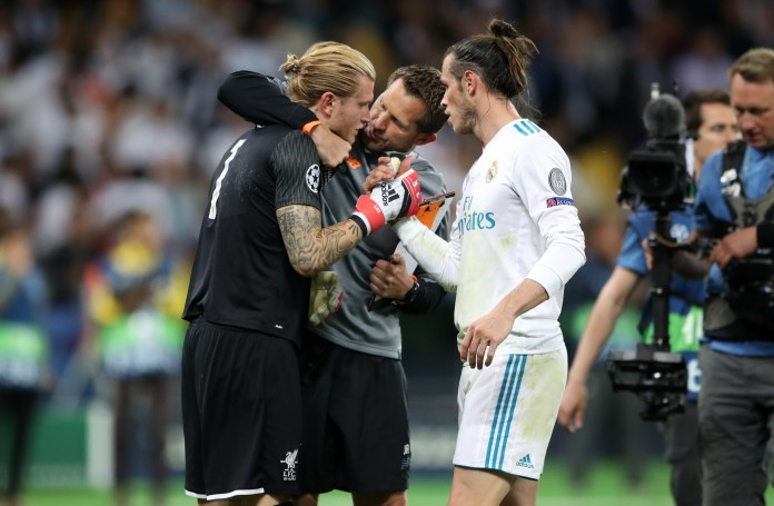 Karius is consoled by Liverpool goalkeeping coach John Achterberg and Bale
