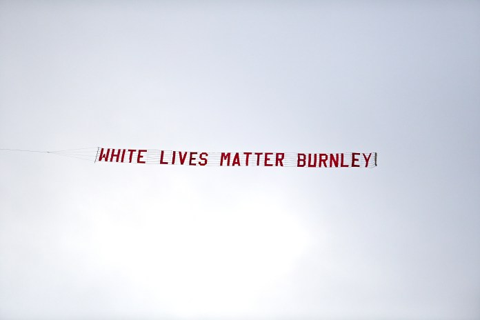 A plane with a White Lives Matter Burnley banner was flown over the Etihad Stadium before the Manchester City v Burnley Premier League match on June 22