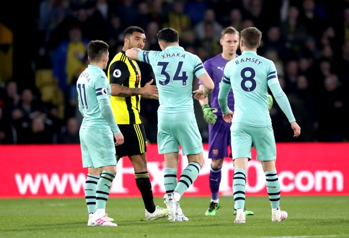 Troy Deeney, second from left, talks to Granit Xhaka from Arsenal