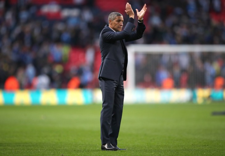Brighton manager Chris Hughton applauds the fans