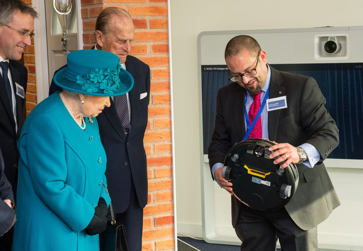 Dr Ian Levy meeting the Queen and the Duke of Edinburgh at GCHQ (Dominic Lipinski/PA)