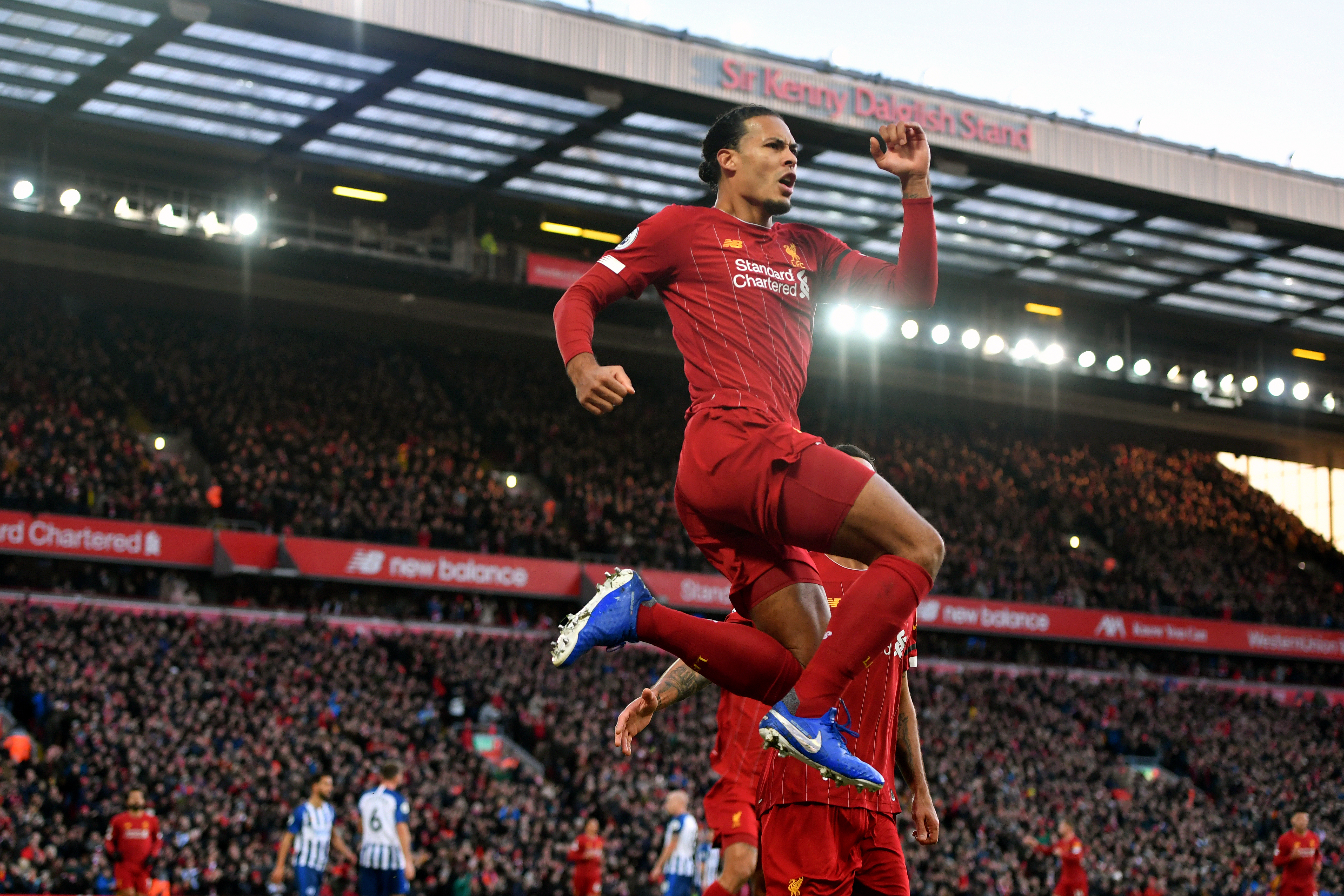 Virgil van Dijk was the unlikely goalscoring hero when Liverpool scraped past Brighton at Anfield. The Holland defender headed two first-half goals before the hosts were forced to hang on for a 2-1 victory following the dismissal of goalkeeper Alisson Becker