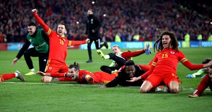 Wales' Aaron Ramsey (10), Gareth Bale (centre) and Ethan Ampadu (15) celebrate after securing qualification for Euro 2020