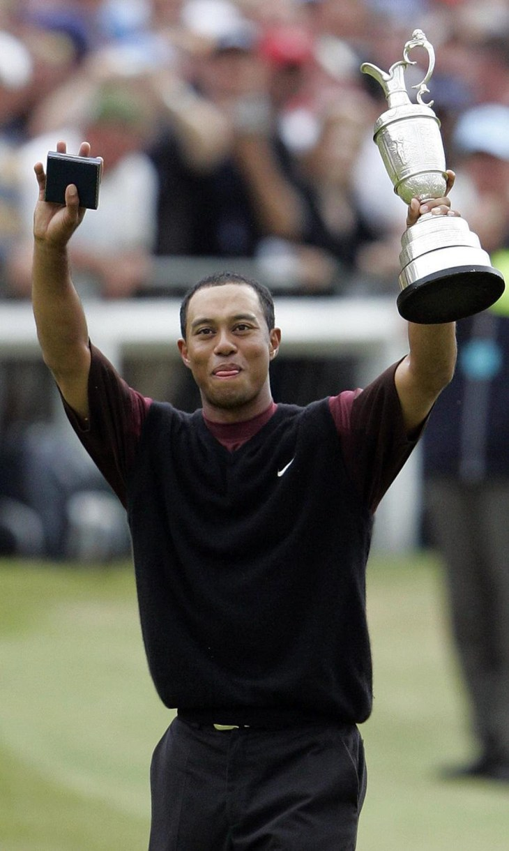 Tiger Woods celebrates winning the 134th Open Championship in 2005