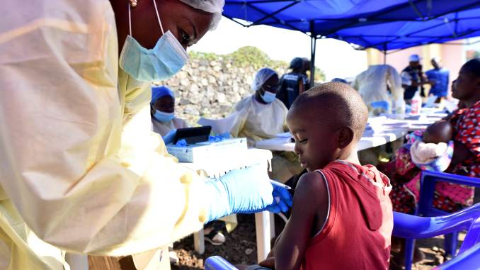 A Congolese health worker administers ebola vaccine to a child at the Himbi Health Centre in Goma, Democratic Republic of Congo, July 17, 2019.