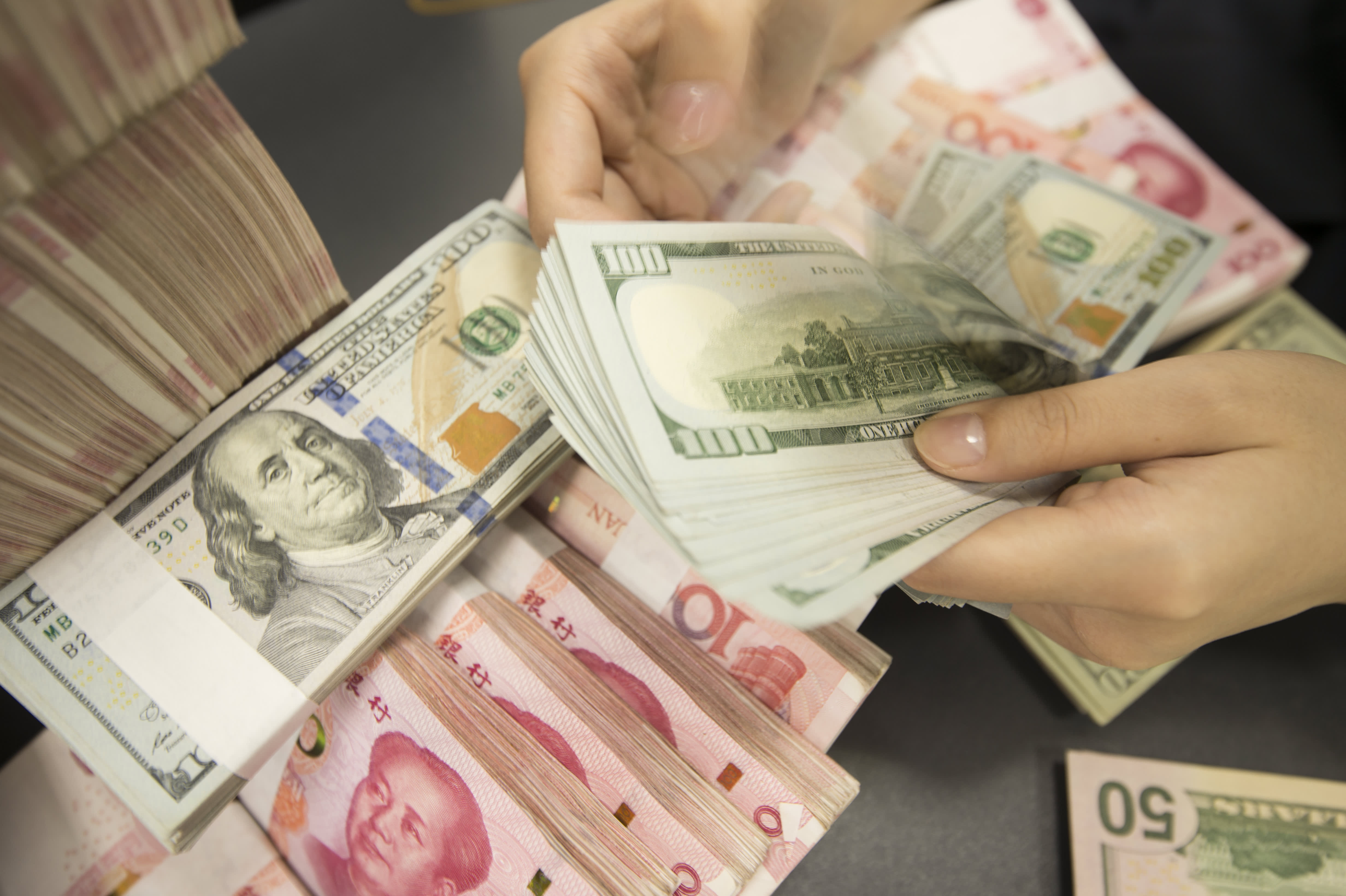 The yuan won't unseat the dollar soon — but it could grow in prominence if China dominates in tech and trade