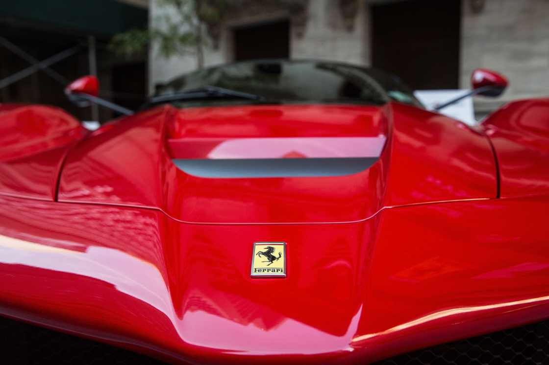 A Ferrari is parked outside the New York Stock Exchange in celebration of Ferrari Automotive Company's IPO on October 21, 2015 in New York City.