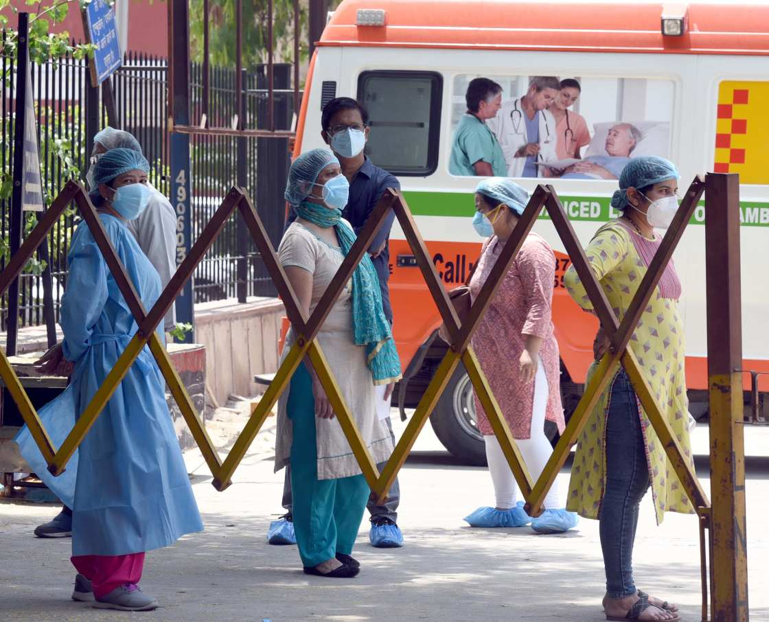 Doctors and medical staff wait for their turn during the collection of samples for Covid-19 testing at LNJP Hospital, during nationwide lockdown to curb the spread of coronavirus, on May 9, 2020 in New Delhi, India.