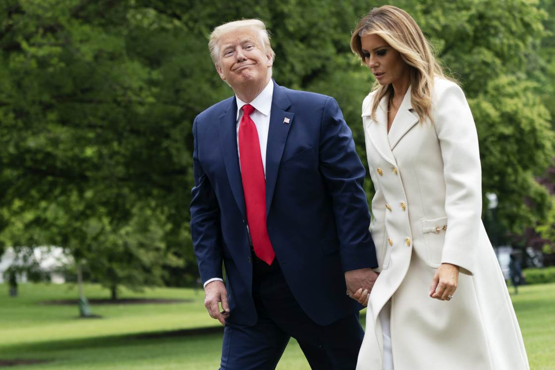 President Donald Trump and First Lady Melania Trump walk on the South Lawn of the White House after arriving on Marine One in Washington, D.C., U.S., on Monday, May 25, 2020.