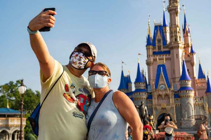 Disney to lay off 28,000 employees as coronavirus slams theme park business