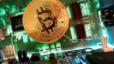 Representation of the virtual currency Bitcoin is seen on a motherboard in this picture illustration taken April 24, 2020.