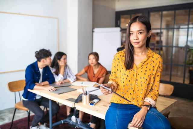 How the model minority myth holds Asian Americans back at work—and what companies should do