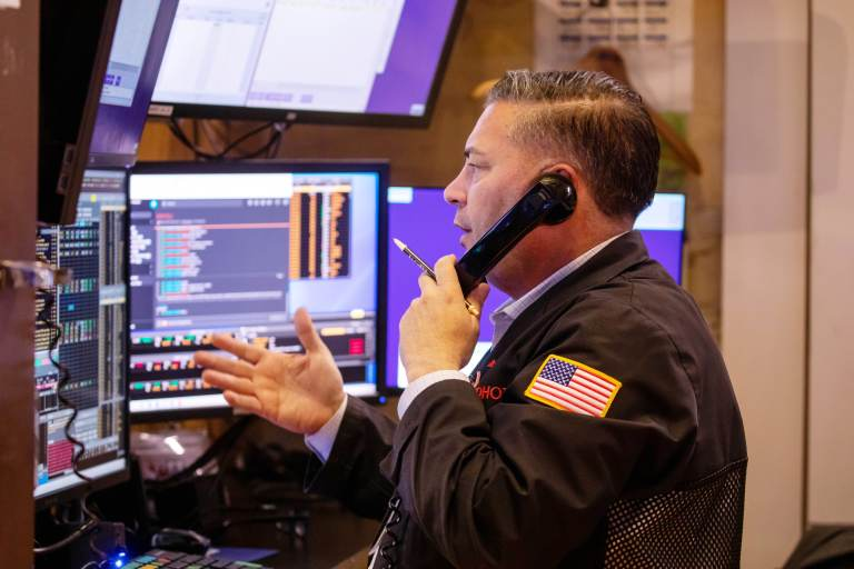 Stock futures rise in overnight trading after market ends wild week in the green