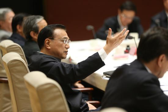 Premier Li Keqiang presides over a meeting on April 18, 2017. (Photo by Feng Yongbin/China Daily)