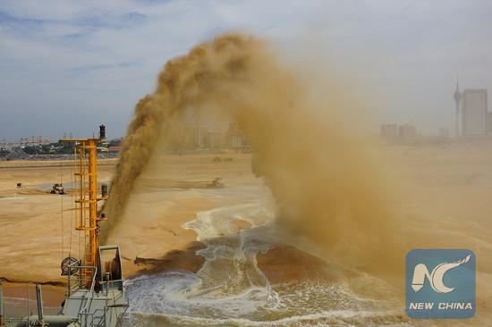 Land reclamation completed for China-funded port city in ...