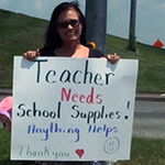 teacher panhandles for school supplies