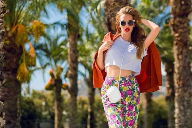Amazing blonde woman in trendy summer outfit posing outdoors Free Photo