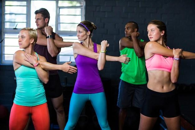 Athletes exercising in fitness studio Premium Photo