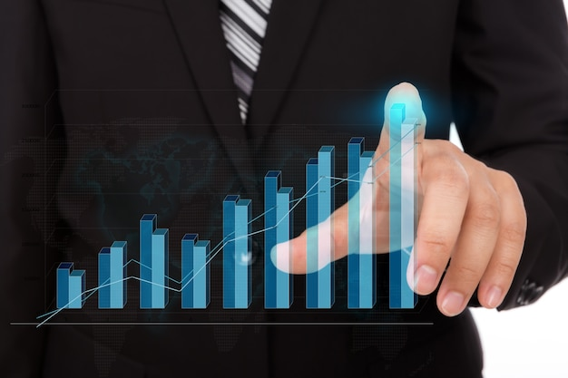 Businessman touching the tip of a bar chart Free Photo