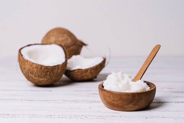 Coconul oil in wooden bowl Free Photo