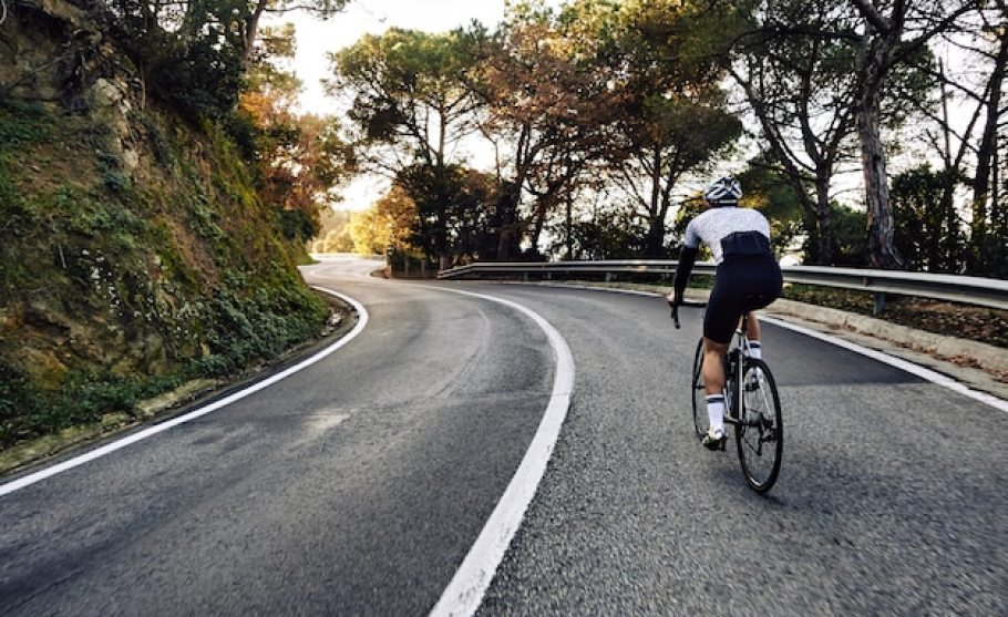 Cyclist man riding a bike on the road Free Photo