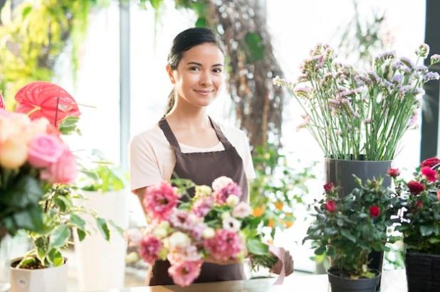 Girl working in florist shop Premium Photo