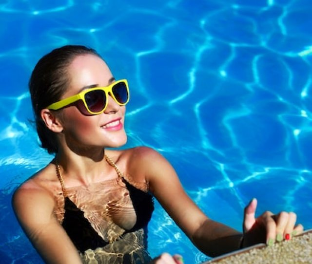 Happy Tanned Girl Posing In The Pool Free Photo