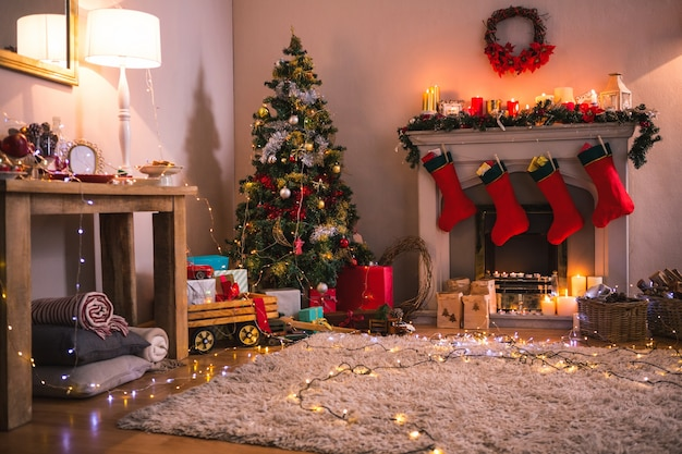 Living Room With Fireplace And Christmas Tree Photo