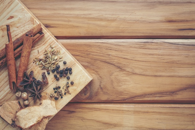 Many chinese medicines that are put together on a light brown wood floor. Free Photo